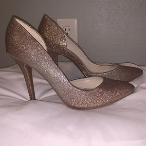 Juicy Couture gold glitter stiletto heels.